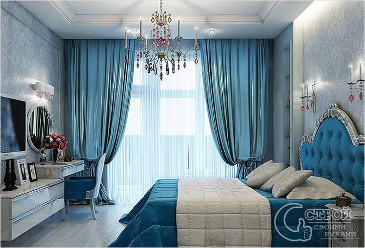 Голубые атласные шторы в спальне